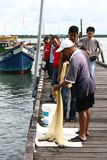 Fisherman caught fish Stock Photography