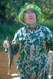 A fisherman caught a pike Stock Images