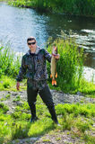 The fisherman with the caught  pike Stock Photos