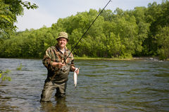 Fisherman caught a salmon Stock Photo