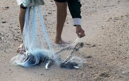 The fisherman caught selling fish. Country located on the beach for sale, thailand Royalty Free Stock Image