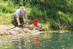 Fisherman checking fishing rod Stock Photos