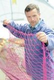 Fisherman checking the net. Fisherman stock image