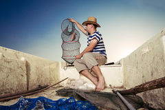 Fisherman checking the net for a catch Royalty Free Stock Photos