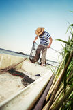 Fisherman checking the net for a catch Stock Photography