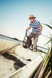 Fisherman checking the net for a catch Stock Photo