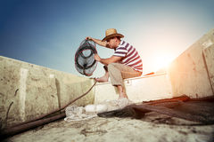 Fisherman checking the net for a catch Royalty Free Stock Photo