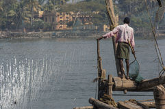 Fisherman on the Chinese fishing nets Royalty Free Stock Photography