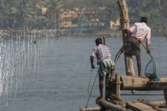 Fisherman on the Chinese fishing nets Stock Photography