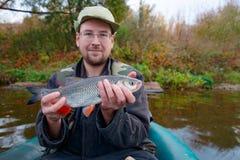 Fisherman with chub Stock Photo