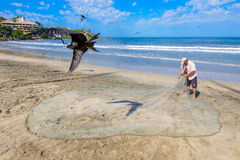 A fisherman cleaning his nets Royalty Free Stock Photography