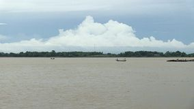 Fisherman, cloudy, mekong, cambodia, southeast asia stock video footage
