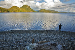 The fisherman on coast of ocean passage. Royalty Free Stock Photography