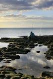 The fisherman at coast Royalty Free Stock Photography