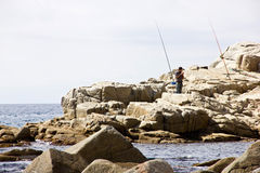 Fisherman on the coast of Tossa de Mar. A fisherman waiting for a fish to the bait royalty free stock images