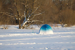 Fisherman color tent on frozen river with snow Royalty Free Stock Images