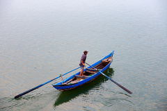 Fisherman come home in O Loan lagoon, Phu Yen, Vietnam. A brackish water lagoon which is right at the end of Quan Cau (Quán Cau) pass, is very near the royalty free stock image