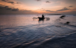 Fisherman comeback after a day working Royalty Free Stock Photography