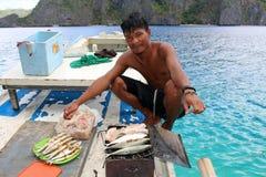 Fisherman cooking Royalty Free Stock Image
