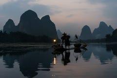 Fisherman cormorant Li river, Guilin Yangshuo Guangxi  China. Yangshuo , China - September 29 , 2014 : fisherman fishing  with cormorant Li river, between Guilin Royalty Free Stock Photography