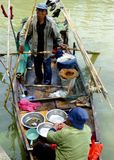 A fisherman couple selling fishes Royalty Free Stock Photography