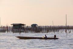 Fisherman crossing a lake Royalty Free Stock Photography