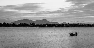 Fisherman crossing the Thu Bon River near Hoi An in Vietnam, Indochina, Asia royalty free stock photo