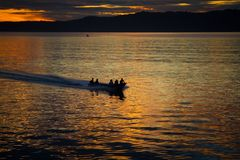 The fisherman are cruising to the ocean for fishing on beautiful sunrise. The fisherman are cruising to the ocean for fishing on beautiful golden sunrise stock photography