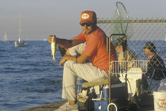 A fisherman displaying his catch Royalty Free Stock Image