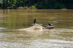 Fisherman do fishing on river Stock Images