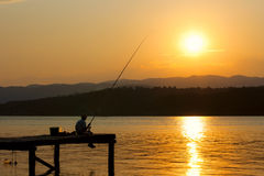 Fisherman on the dock Stock Photography