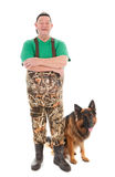 Fisherman with dog Stock Photos