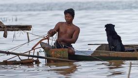 Fisherman with dog, Tonle Sap, Cambodia Stock Photos
