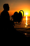 Fisherman down  silhouettes Stock Images