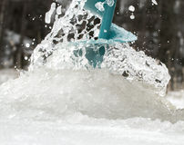 Fisherman drilling ice Stock Images