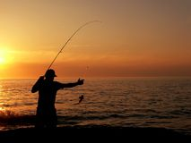 Fisherman at dusk Royalty Free Stock Images