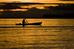 Fisherman at dusk Stock Photography