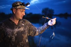 Fisherman at dusk on river Stock Photography