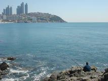 Fisherman enjoyed his days at Haeundae beach Stock Image