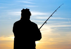 Fisherman at evening Stock Photo