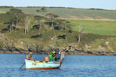 Fisherman facing the coast of Cornwall Royalty Free Stock Photography
