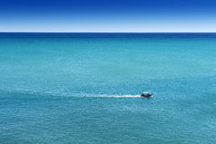 The fisherman. A fisherman falls from a fishing trip in a beautiful day Stock Image