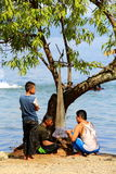 Fisherman families. 3 men try to fix their net before catch the fish on the lake of singkarak at west sumatra, bright sunny day Stock Image