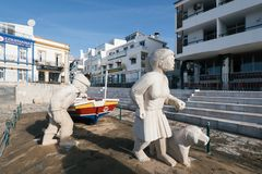Fisherman family statue in Albufeira city. Stock Photo