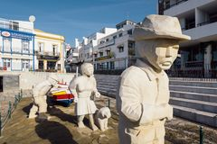Fisherman family statue in Albufeira city. Stock Photos