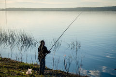 Fisherman with feeder rod Stock Image