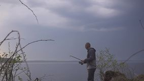 Fisherman finishes fishing on the lake in the morning,. Fisherman begins fishing on the lake in the morning hd stock video