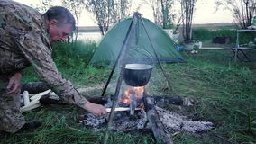 A fisherman by the fire stock footage