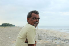 The Fisherman. The first person i met on my journey to Alappuzha Beach.He shared with me some of  his thoughts and history of that place Stock Photos