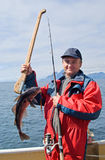 Fisherman with fish. On the boat near the Lofoten island Stock Images